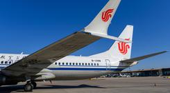 A grounded Air China 737 Max 8 sits on the tarmac at Beijing. Photo: REUTERS