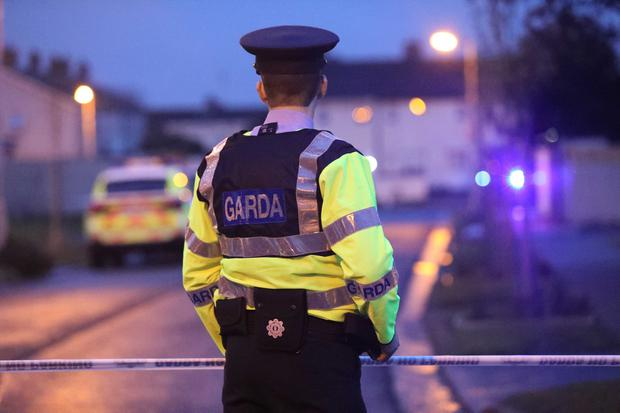 The extraordinary incident lasted under 10 minutes and began about 4.40pm when a member of the public reported seeing a man armed with a suspected machine gun near the Centra store at Poppintree.