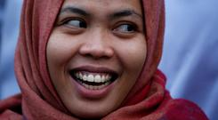 Home: Siti Aisyah laughs during a news conference at the airport in Jakarta, Indonesia, yesterday. Photo: Reuters/Willy Kurniawan