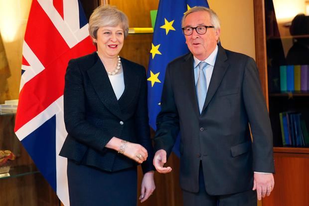 Struck a deal: British Prime Minister Theresa May met with European Commission President Jean-Claude Juncker in Strasbourg. AP photo
