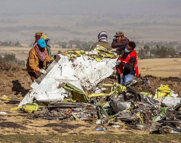 Rescuers work at the scene of the crash