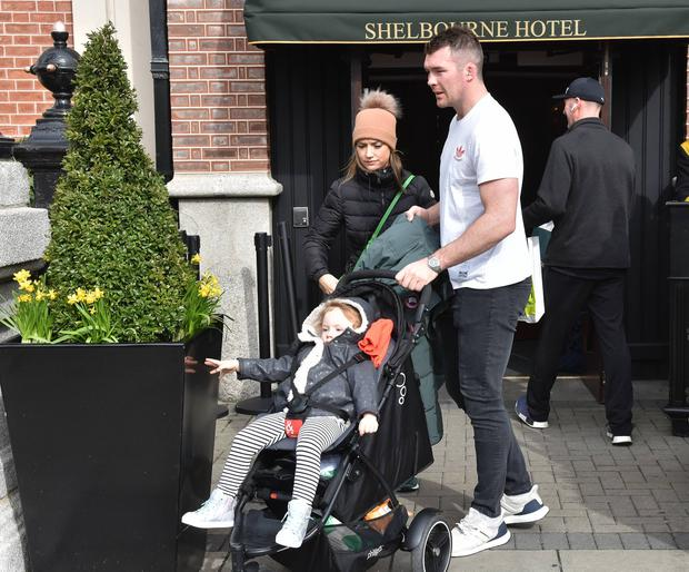 Peter O'Mahoney, Jessica Moloney and their daughter Indie O'Mahoney (daughter) seen leaving The Shelbourne Hotel a day after beating France in the Six Nations