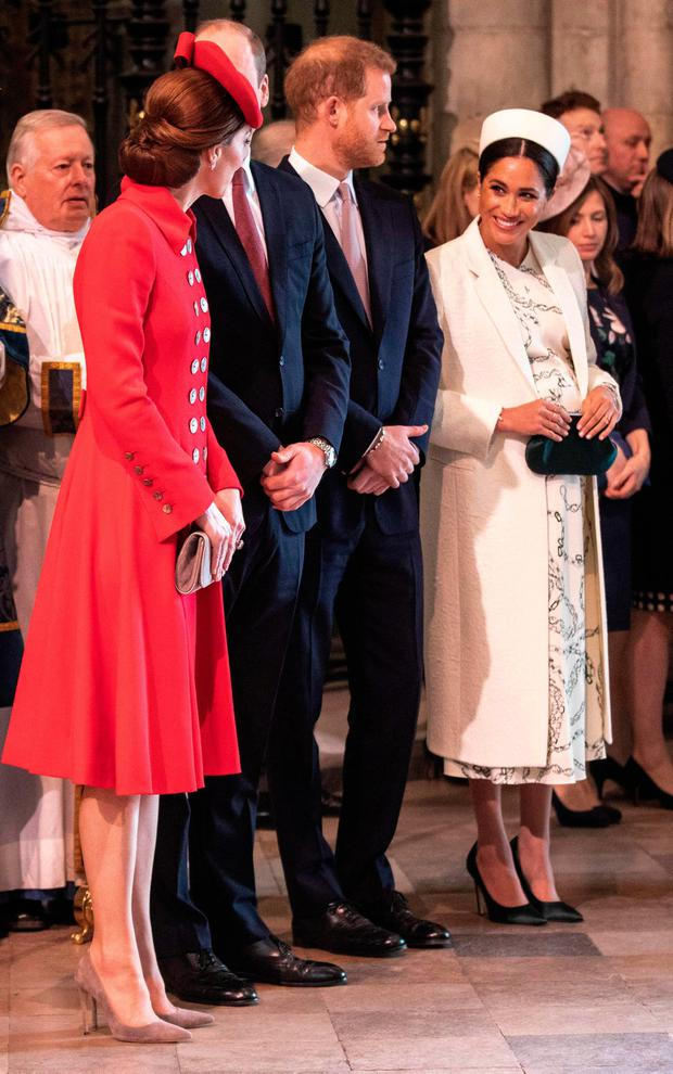 (L-R) Britain's Catherine, Duchess of Cambridge (L), talks with Britain's Meghan, Duchess of Sussex (R) as Britain's Prince William, Duke of Cambridge, and Britain's Prince Harry, Duke of Sussex, stand by attending the Commonwealth Day service at Westminster Abbey in London on March 11, 2019