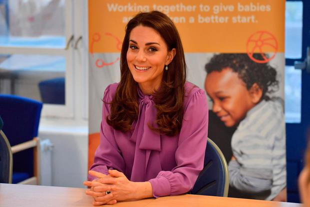 Kate Middleton Plays With Babies During Visit to Children's Center in London