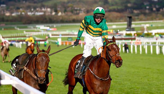 Jockey Mark Walsh on his way to winning the Unibet Champion Hurdle Challenge Trophy with Espoir D'allen during Champion Day of the 2019 Cheltenham Festival at Cheltenham Racecourse.