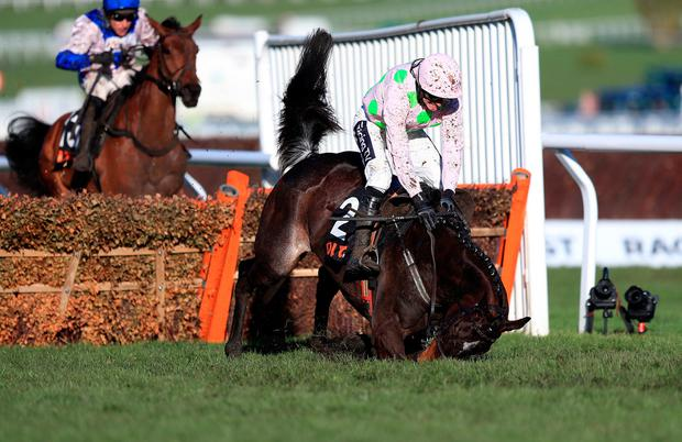 Benie Des Dieux ridden by jockey Ruby Walsh goes down in the OLBG Mares' Hurdle during Champion Day of the 2019 Cheltenham Festival at Cheltenham Racecourse. Simon Cooper/PA Wire.