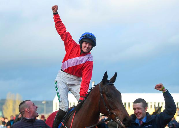 Rachael Blackmore celebrates on A Plus Tard after winning the Close Brothers Novices' Handicap Chase on Day One of the Cheltenham Racing Festival at Prestbury Park in Cheltenham, England. Photo by David Fitzgerald/Sportsfile
