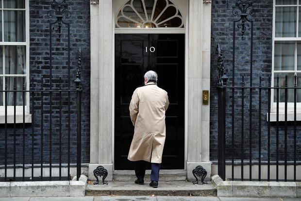 Man of the moment: Britain's attorney general Geoffrey Cox enters No 10 Downing Street in London yesterday. Photo: REUTERS/Toby Melville
