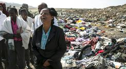 Disaster: Kebebew Legesse, the mother of Ethiopian Airlines cabin crew Ayantu Girmay, mourns at the scene of the crash. Photo: REUTERS/Baz Ratner