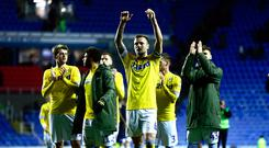 READING, ENGLAND - MARCH 12: Leeds Captain Liam Cooper celebrates with his team after winning the Sky Bet Championship match between Reading and Leeds United at the Madejski Stadium on March 12, 2019 in Reading, England. (Photo by Jordan Mansfield/Getty Images)
