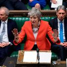 Clearing her throat: UK Prime Minister Theresa May at the start of the debate on the second meaningful vote on her government's Brexit deal in the House of Commons yesterday. Photo: AFP/Getty Images