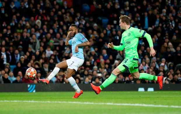 Manchester City's Raheem Sterling scores his side's fourth goal. Photo: Martin Rickett/PA Wire
