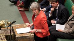 Britain's Prime Minister Theresa May speaks to Parliament after the results of the vote on Brexit deal. Photo: REUTERS