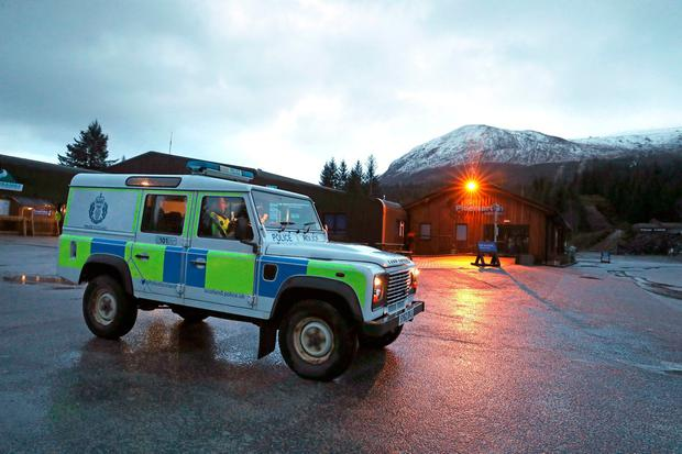 A Police vehicle at the Nevis Range Mountain Resort with Ben Nevis behind. Photo: Andrew Milligan/PA Wire
