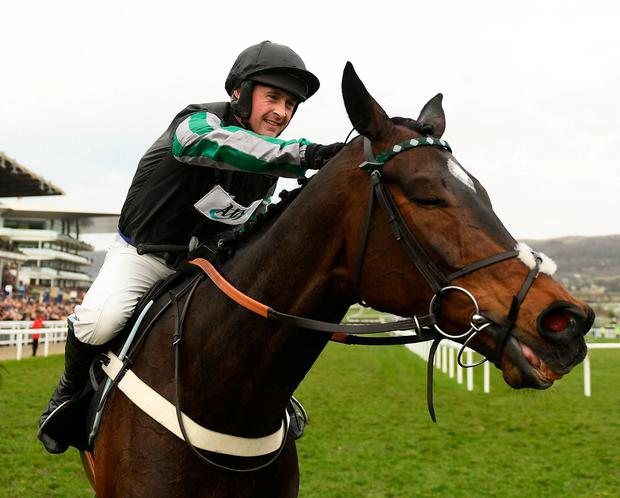 Jockey Nico de Boinville celebrates after winning The Betway Queen Mother Champion Steeple Chase on Altior on Day Two of the Cheltenham Racing Festival last year. Photo by Ramsey Cardy/Sportsfile