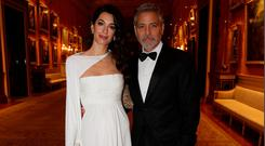 Amal Clooney and George Clooney attend a dinner to celebrate The Prince's Trust, hosted by Prince Charles, Prince of Wales at Buckingham Palace on March 12, 2019 in London, England