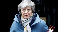 British Prime Minister Theresa May walks outside Downing Street in London, Britain March 13, 2019. REUTERS/Henry Nicholls