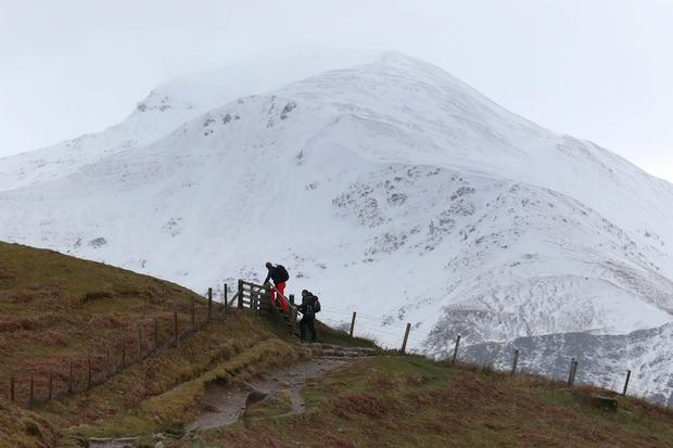 Hill walkers make their way along the Ben Nevis mountain path in Scotland. A young climber is being treated for serious injuries after an avalanche on the UK's highest mountain