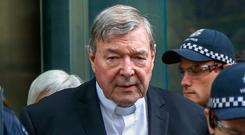 Pell is led away to begin his sentence. Image: AP Photo/Asanka Brendon Ratnayake, File