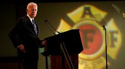 "Biden: ""In America, everybody gets a shot."" Photo: Reuters/Kevin Lamarque"