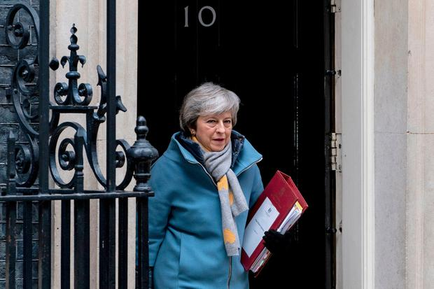 Clinging on: Theresa May has boxed herself in to a corner with no wriggle room. Photo: Getty Images