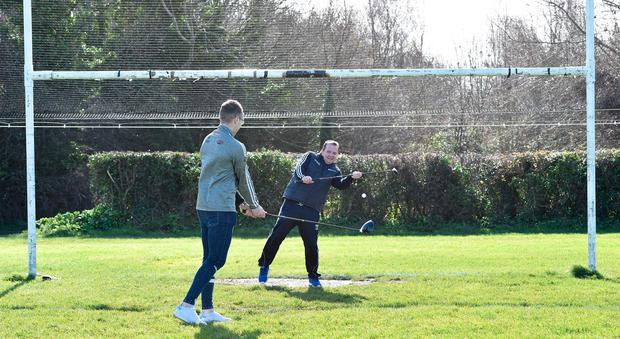 Wexford hurling manager Davy Fitzgerald makes a save with a golf club from Waterford hurler Kieran Bennett at the launch of the KN Group All-Ireland GAA Golf Challenge which takes place in August. Photo by Matt Browne/Sportsfile