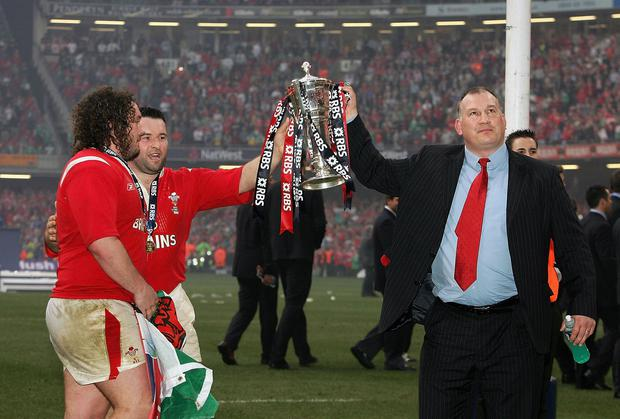 Head coach Mike Ruddock (right) with Adam Jones and Mefin Davies after guiding Wales to a 32-20 victory over Ireland to seal Grand Slam glory in 2005. Photo: David Rogers/Getty Images