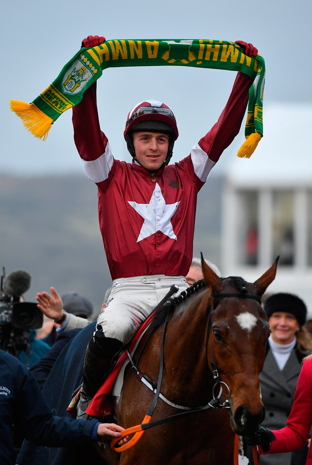 Winning Meath jockey Keith Donoghue raises his county colours following victory. Photo by Seb Daly/Sportsfile