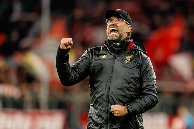 Head coach Jurgen Klopp of Liverpool celebrates after winning the UEFA Champions League Round of 16 Second Leg match between FC Bayern Munich and Liverpool at the Allianz Arena (Photo by TF-Images/Getty Images)