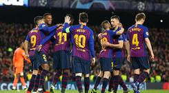 Lionel Messi celebrates with team mates during the UEFA Champions League Round of 16 Second Leg match between FC Barcelona and Olympique Lyonnais (Photo by Maja Hitij/Getty Images)
