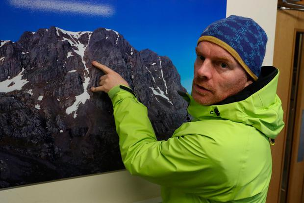 Death ridge: Mountain rescue team member Donald Paterson points to the spot on Ben Nevis where an avalanche swept away the climbers. Picture: PA
