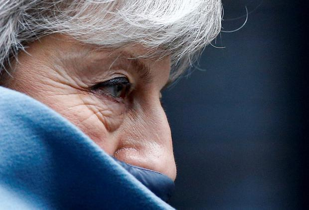 Cornered herself: British Prime Minister Theresa May leaves Downing Street yesterday on her way to the House of Commons. Photo: REUTERS/Henry Nicholls