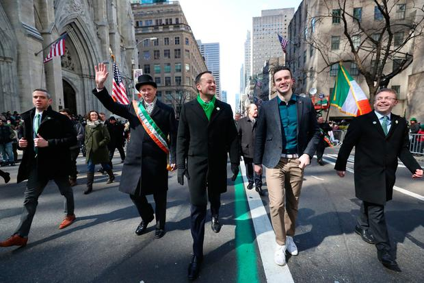 Empire State: Taoiseach Leo Varadkar (centre left) and his partner Matt Barrett walk in the St Patrick's Day parade in New York City. Photo: PA