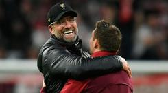 Liverpool manager Jurgen Klopp and James Milner celebrate after the match. Photo: AFP/Getty Images