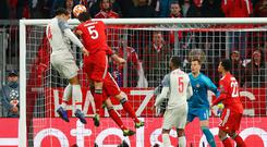 High rise: Virgil Van Dijk leaps above the Bayern Munich defence to score Liverpool's second goal and put them in front in last night's Champions League victory. Photo: Getty