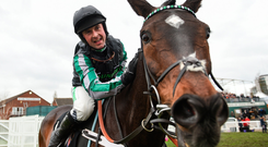 Nico de Boinville celebrates on Altior after winning the Champion Chase for the second year in a row at Cheltenham yesterday. Photo: Sportsfile