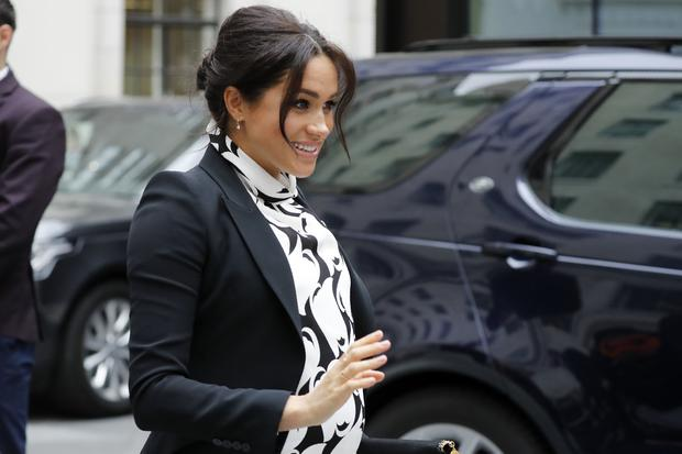 Britain's Meghan, Duchess of Sussex leaves after participating in a panel discussion convened by the Queen's Commonwealth Trust to mark International Women's Day in London on March 8, 2019. (Photo by Tolga AKMEN / AFP)