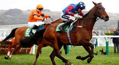 Paisley Park ridden by Aidan Coleman and Sam Spinner ridden by Joe Colliver in action during the 3.30 Sun Racing Stayers' Hurdle REUTERS/Eddie Keogh