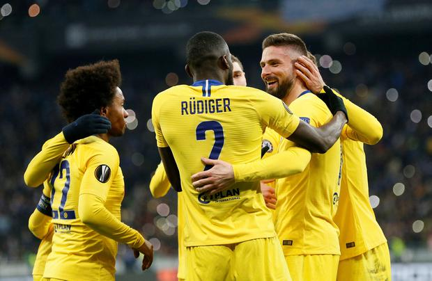 Chelsea's Olivier Giroud celebrates scoring their fourth goal to complete his hat-trick with Antonio Rudiger, Willian and team mates