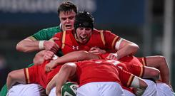 Adam Beard in action against Ireland's James Ryan three years ago during the U20 Six Nations Rugby Championship. Photo: Ramsey Cardy/SPORTSFILE