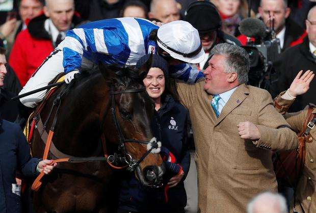 Beaming: Paul Nicholls celebrates with Bryony Frost after her victory aboard Frodon. Photo: Matthew Childs/Reuters