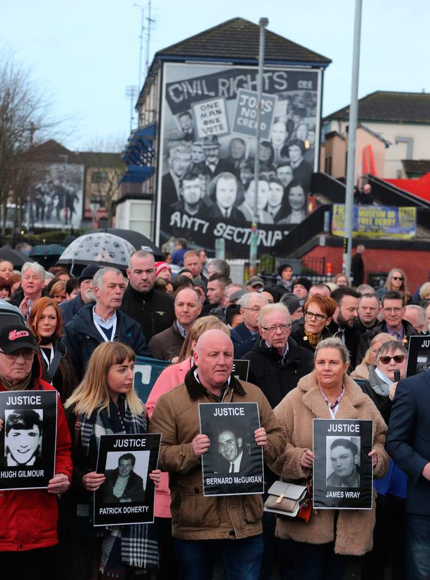 Families of those who were cut down march through the Bogside in Derry.