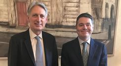 Money men: Britain's chancellor of the exchequer Philip Hammond welcomed Finance Minister Paschal Donohoe to 11 Downing Street yesterday ahead of St Patrick's Day.