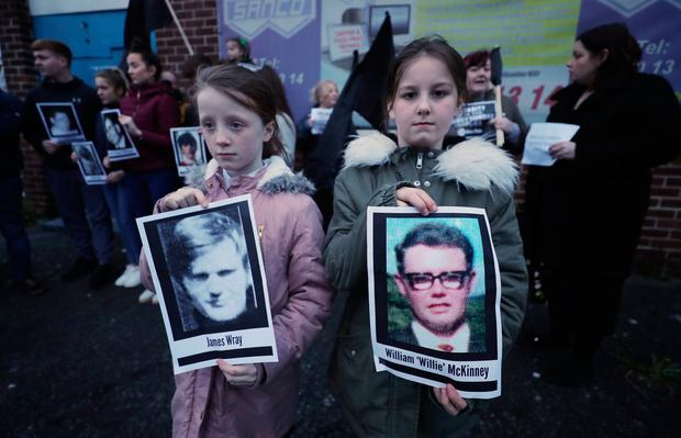 Two children hold pictures of Bloody Sunday victims James Wray and William McKinney during a vigil in West Belfast. Photo: Niall Carson/PA Wire