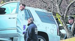 New York City Police officers remove an SUV from the scene outside Cali's home. Photo: Reuters