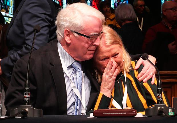Emotion: John Kelly comforts Alana Burke at the Guildhall in Derry after the announcement from the Public Prosecution Service about Bloody Sunday. Photo: PA