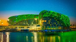 Green initiative: The Yas Hotel in Abu Dhabi, illuminated in green as part of a Tourism Ireland initiative to celebrate St Patrick's Day. Photo: Tourism Ireland