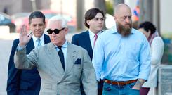 Roger Stone waves as he arrives for a court hearing in Washington yesterday. Photo: Getty Images