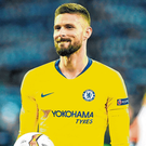 Hat-trick hero: Olivier Giroud with the match ball after Chelsea's 5-0 victory over Dynamo Kiev. Photo: Mike Hewitt/Getty Images