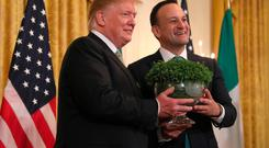 Taoiseach Leo Varadkar presents US President Donald Trump with a bowl of Shamrock Credit: Brian Lawless/PA Wire